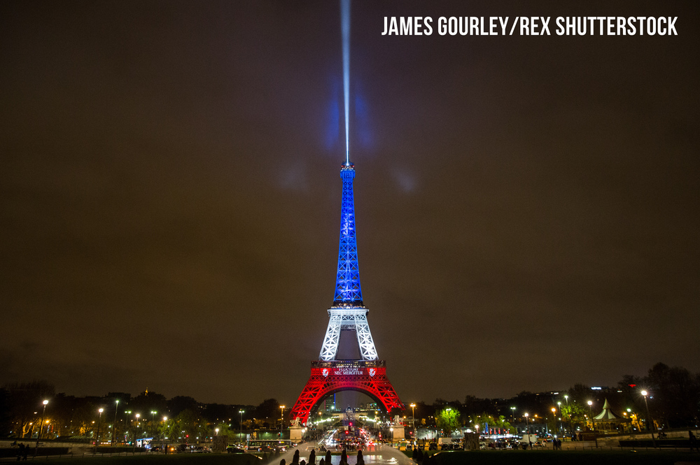 The Eiffel Tower was lit up on Monday night in the French Tricolore colours