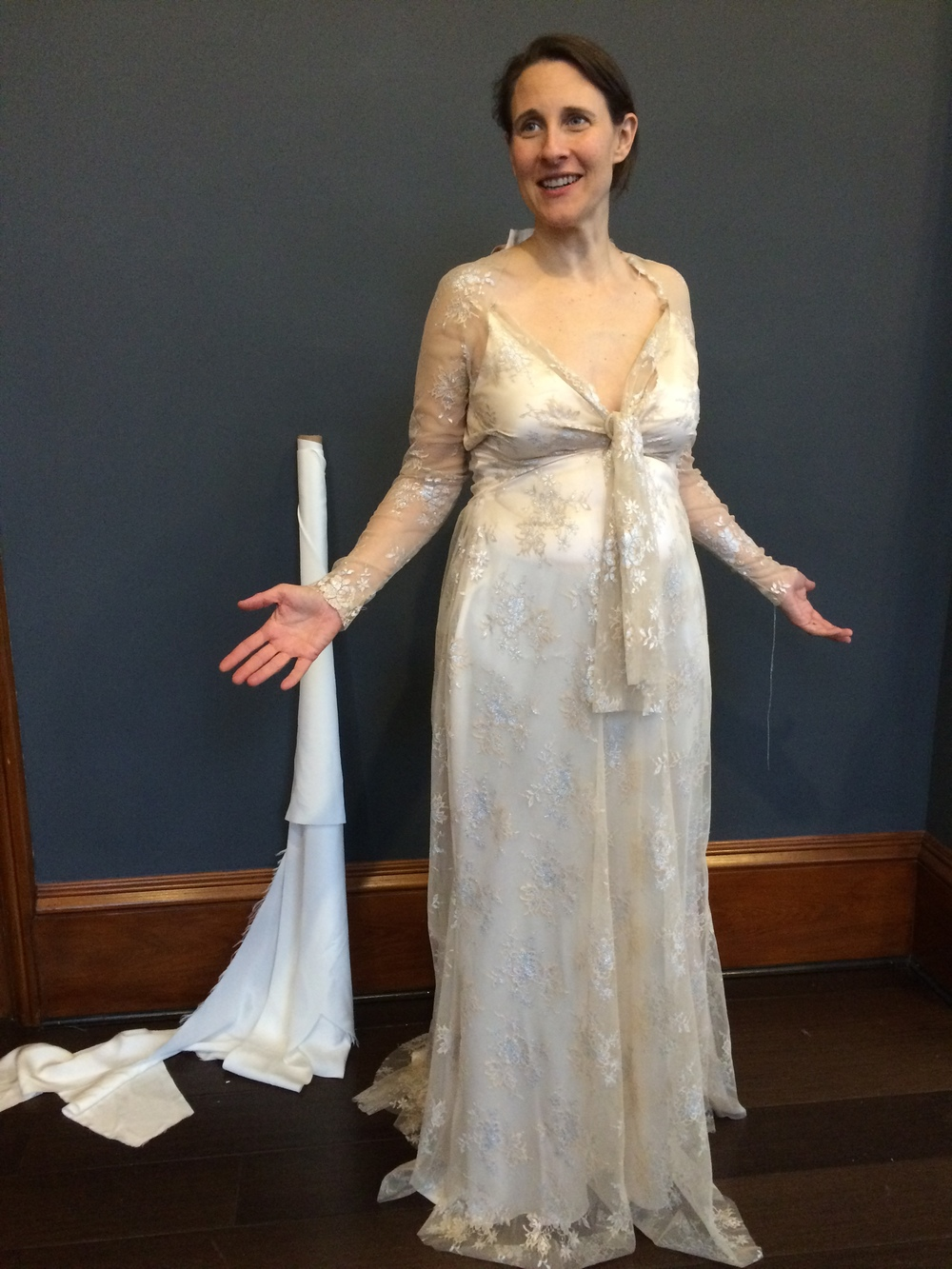 Bride trying on unfinished dress