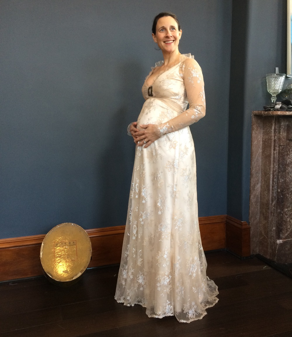 Pregnant bride in her finished wedding dress