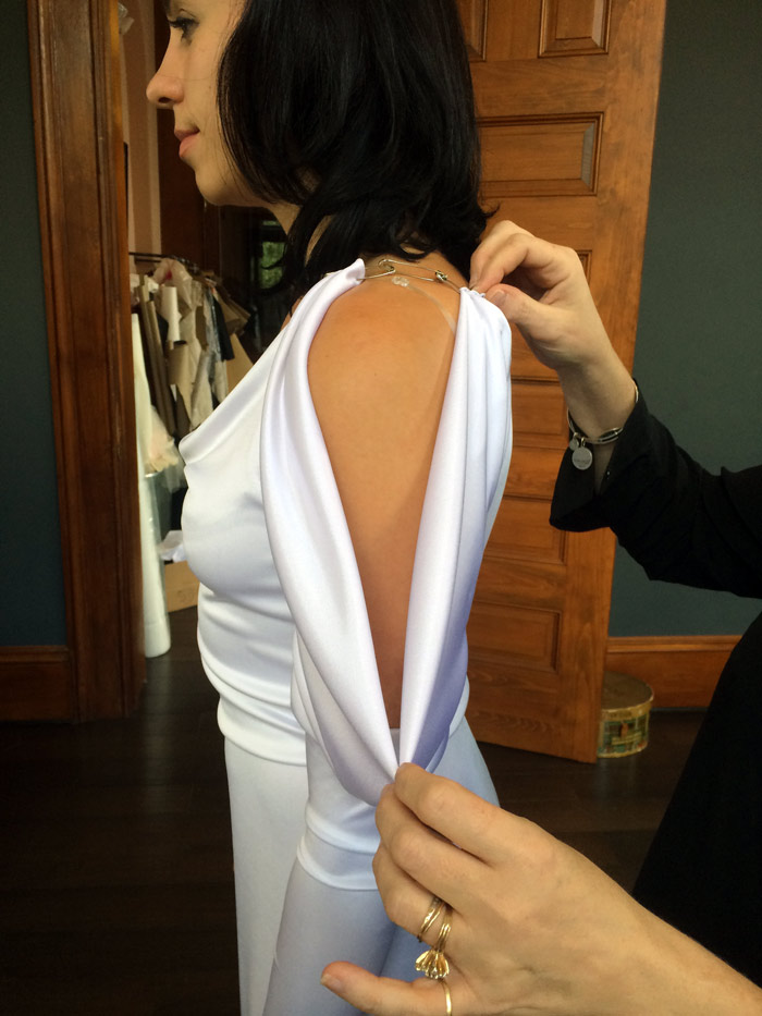 Jill adjusts the drape of this elegant sleeve so that's it's just right.