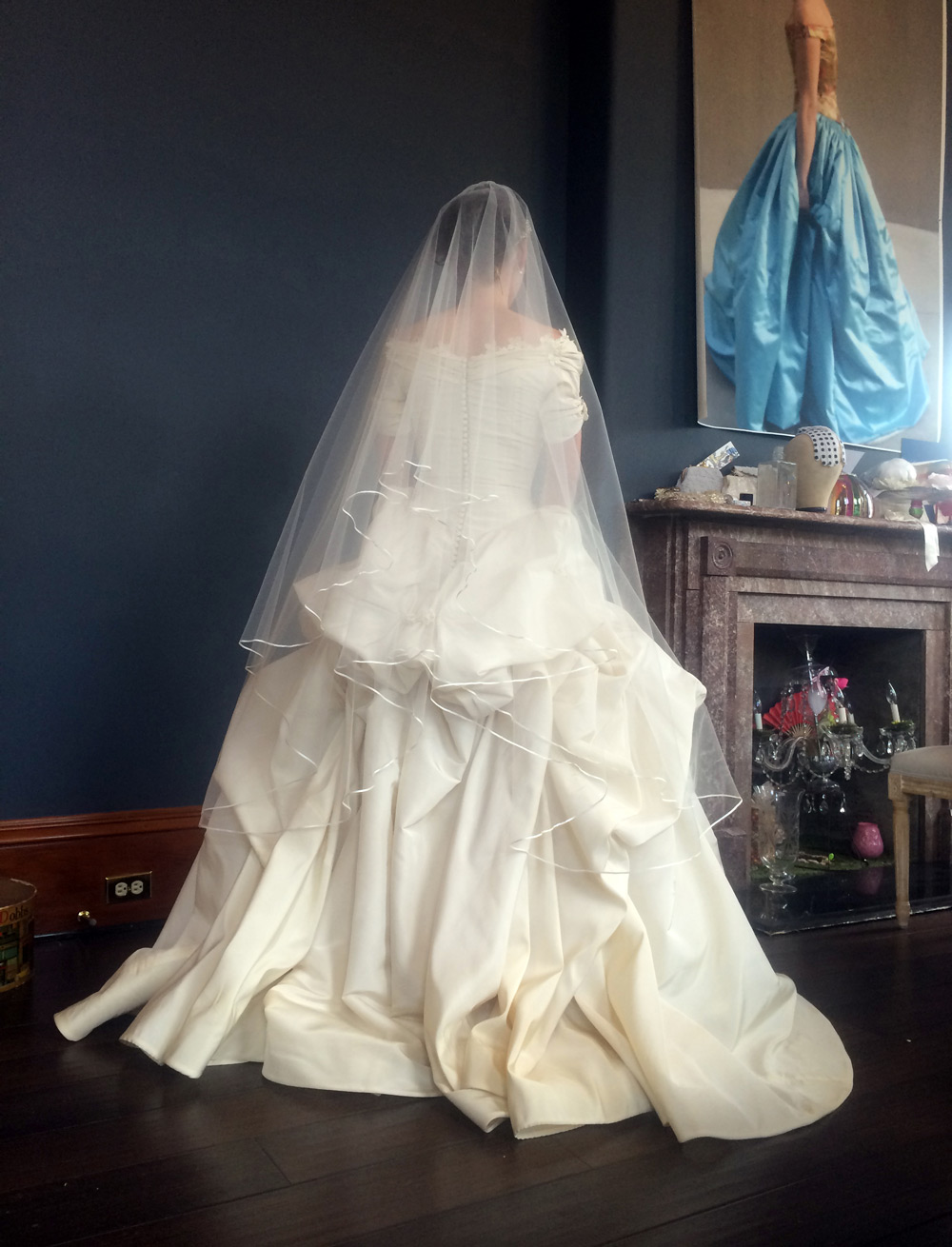 We made Caroline a custom veil with a thin ribbon trim to accentuate the luscious folds of the gown.