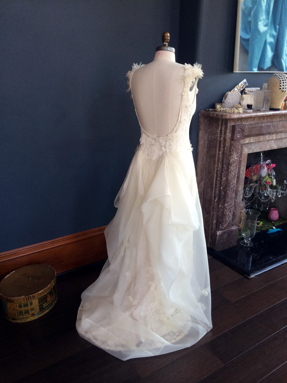 Daisies, roses, and butterflies, oh my! The details on Carter's gown were light as air.