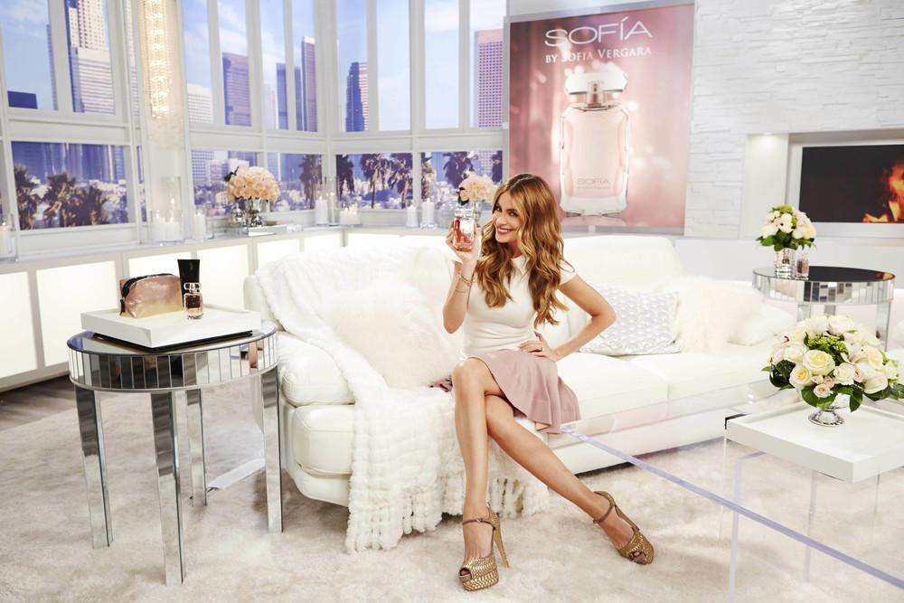 Sofia on couch holding fragrance.jpg