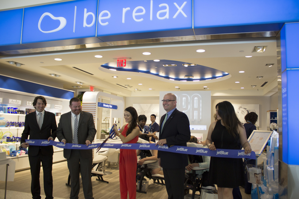 Adeline Moya, Chief Operating Officer Be Relax officially cuts the ribbon to celebrate the opening of Be Relax spa in JFK Airport. She's joined by Nicholas Briest, CEO, Be Relax, Marty St. George, SVP Commercial, JetBlue Airways and Alexandria Dames, GM, Be Relax JFK location.