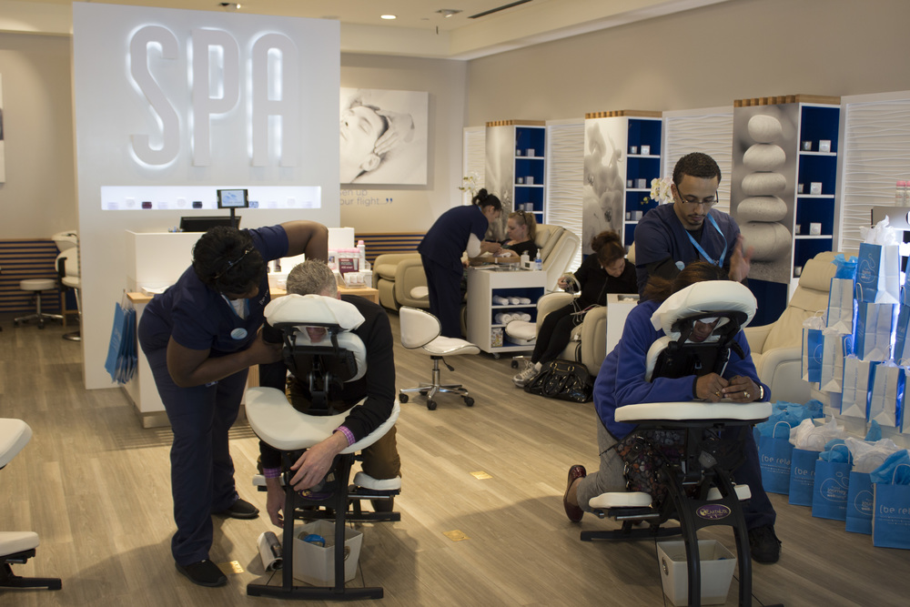 Customers receive complimentary chair massages at Be Relax in JetBlue's T5 to celebrate the opening of the spa's first New York location.