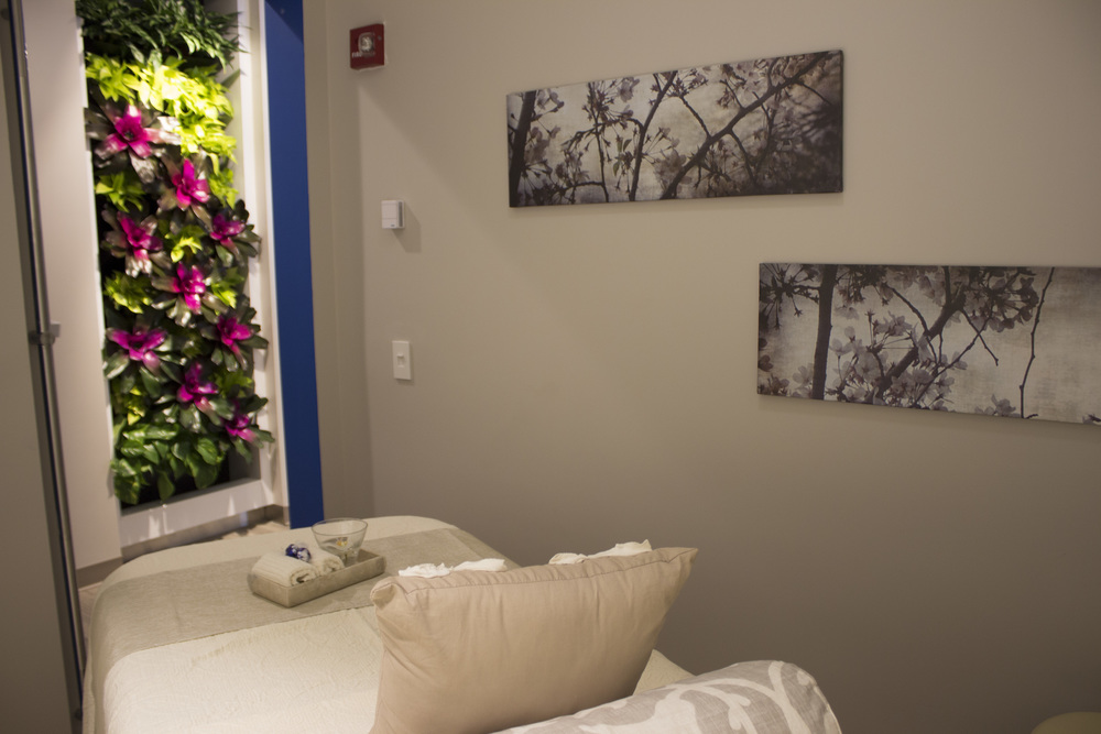 A treatment room for table massages, facials and hair removal services.