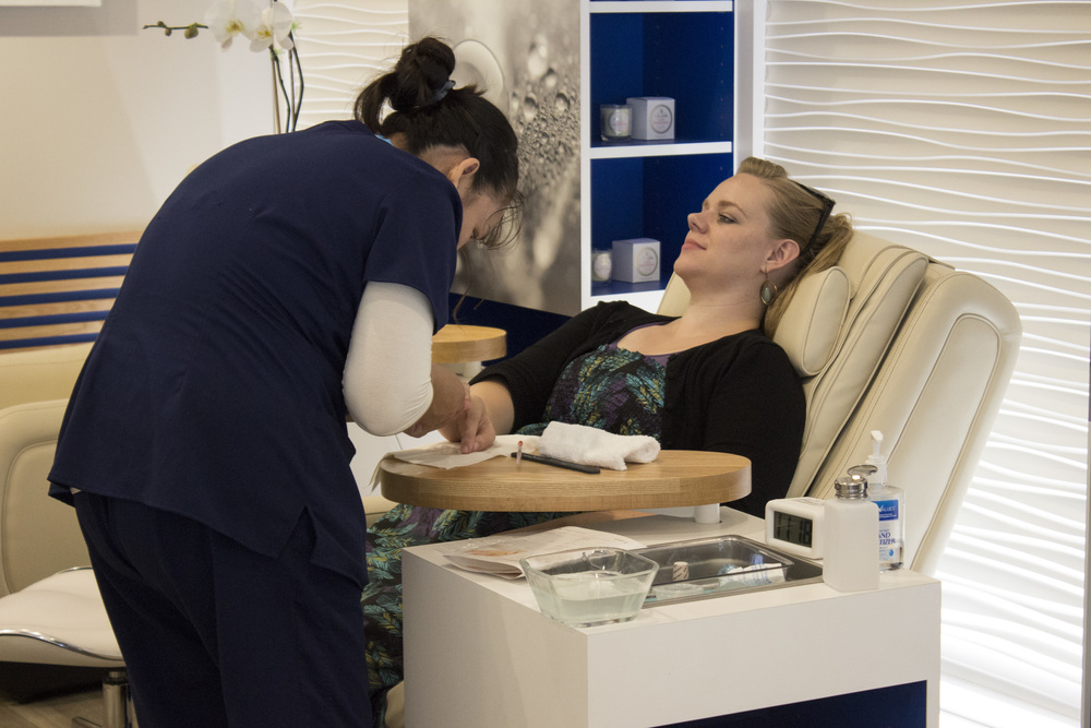 A customer receives a manicure at Be Relax in JetBlue's T5.