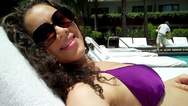 Here I am lounging poolside with my revived curls!
