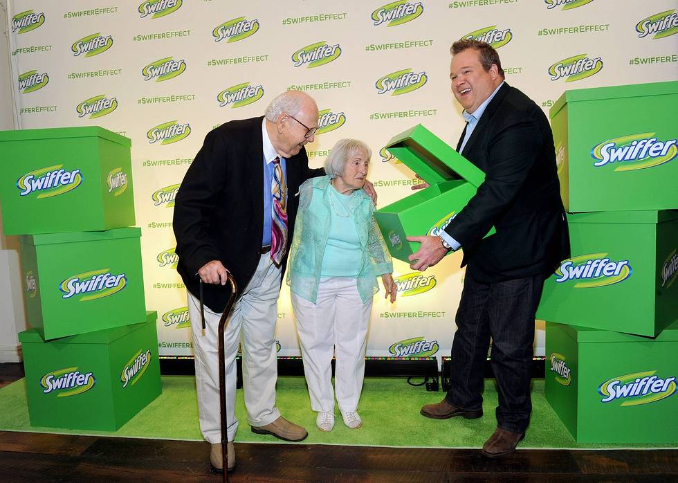 Modern Family's Eric Stonestreet with Morty and Lee Kaufman, of the original   Swiffer   Effect campaign, help spotlight how cleaning can be easier with   Swiffer  's famous Big Green Box, Wednesday, July 23, 2014, in New York.