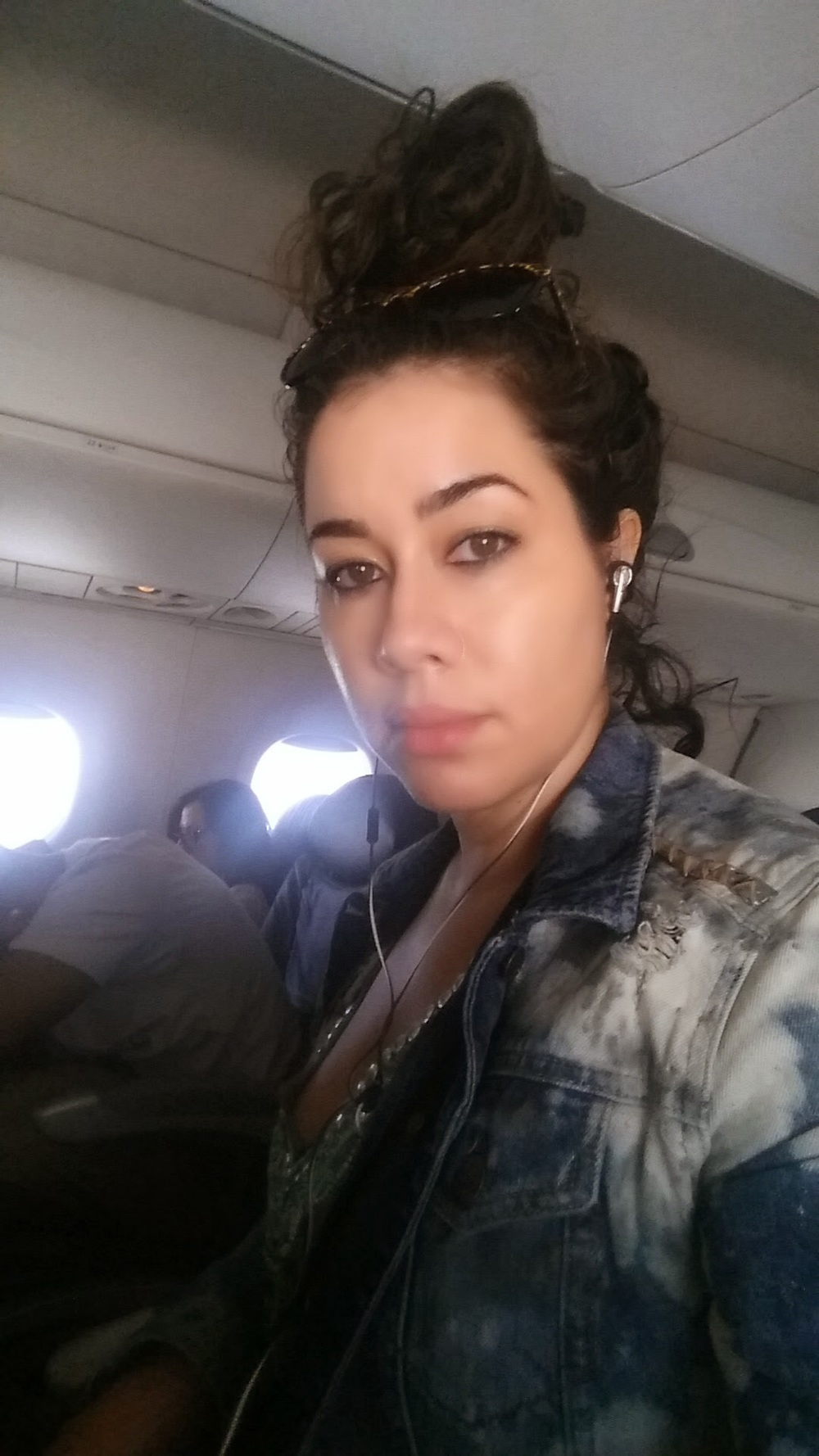 Earbuds & top-knots: My airplane selfie!