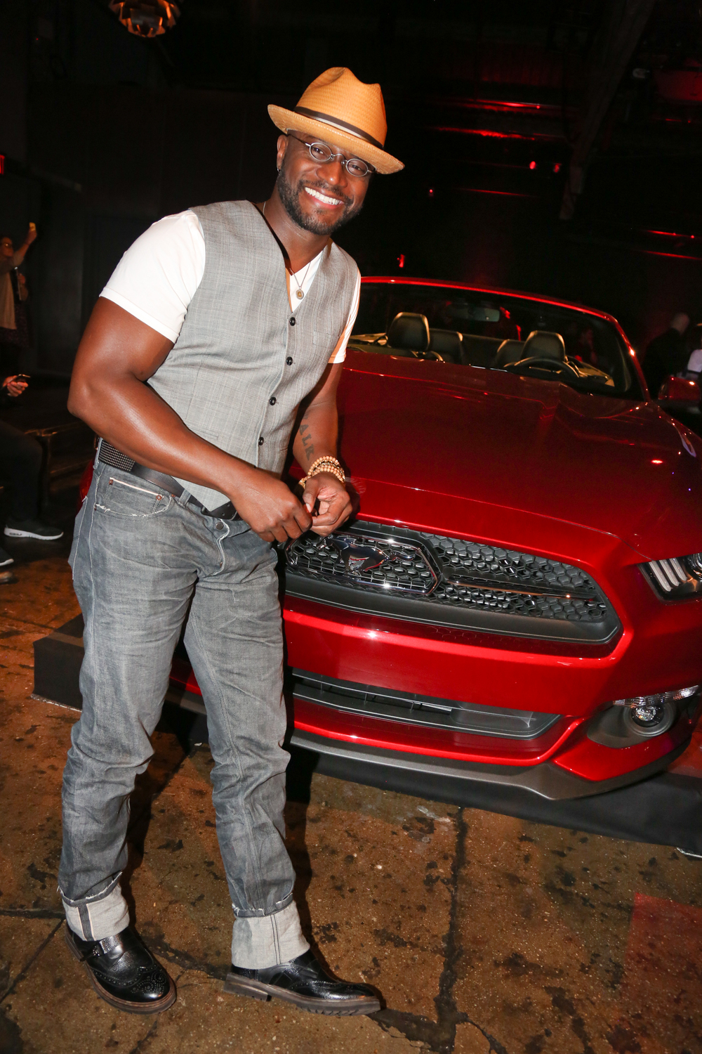 Taye Diggs poses in front of an all-new 2015 Mustang at the Ford and Hard Rock Hotels & Casinos event, 'The Mustang Roadhouse' in New York City.JPG