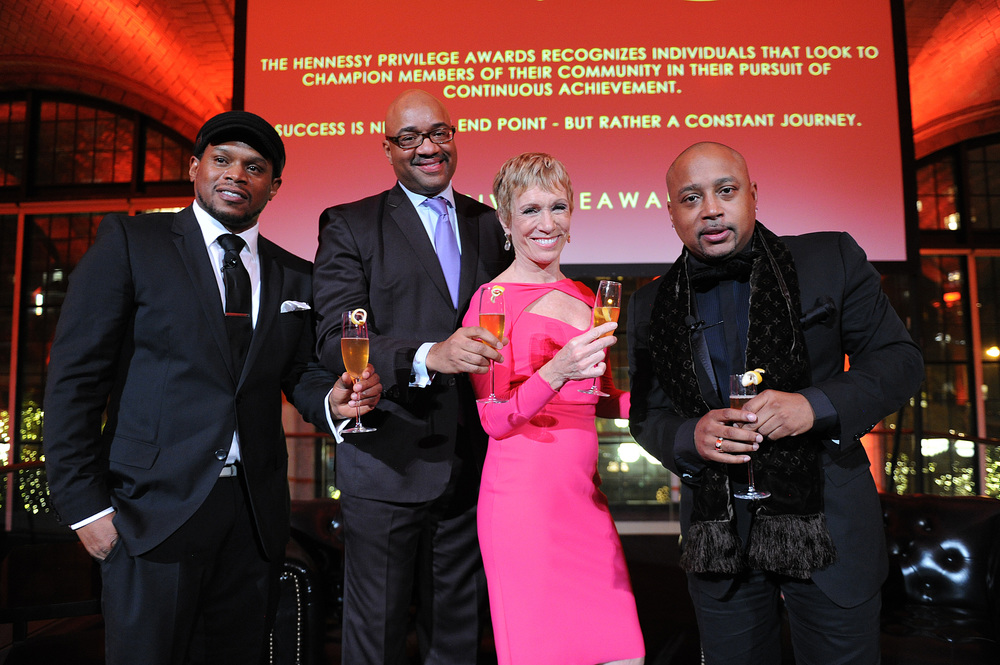 "The evening's host Sway Calloway, Hennessy SVP Rodney Williams, ""Shark Tank's"" Barbara Corcoran and award recipient Daymond John at The Hennessy Privilège Awards."