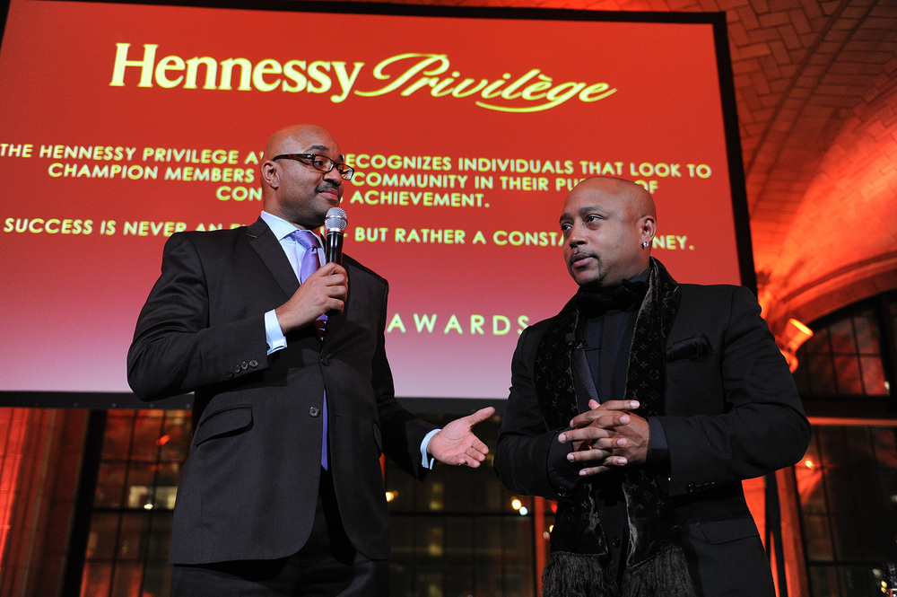 Hennessy SVP Rodney Williams presents The Hennessy Privilège Award to honoree, Daymond John.