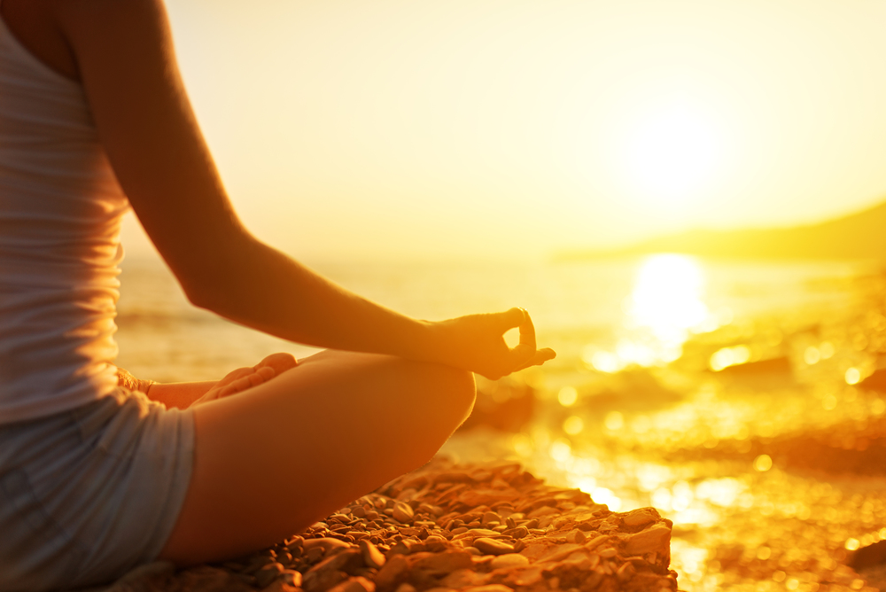 Bigstock- 39779440 - Hand Of  Woman Meditating In A Yoga Pose On Beach.jpg