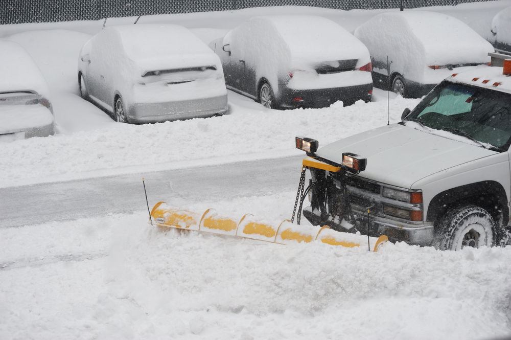 bigstock-snowplow-removing-snow-on-the--113076422.jpg