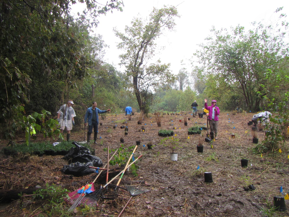 RiparianPlantingDay00027-Soggy and Happy Volunteers.jpg