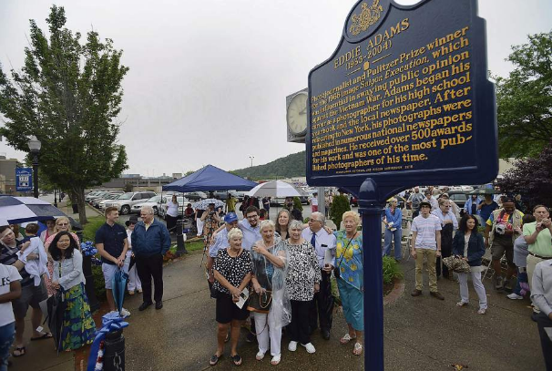 Eddie's family members (center) gather for the unveiling of the new marker.  Photo by Dan Speicher, for The Tribune Review
