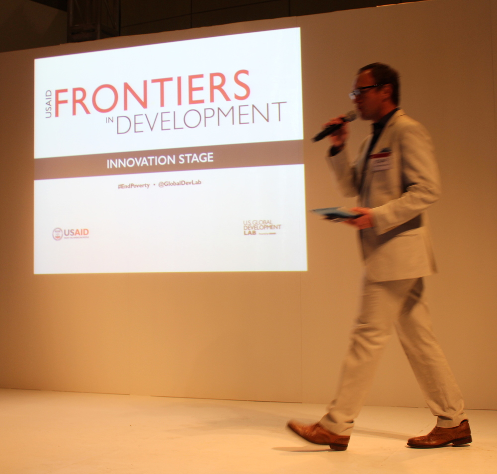 Pierce McManus emcees the Innovation Stage at USAID's Frontiers in Development conference.