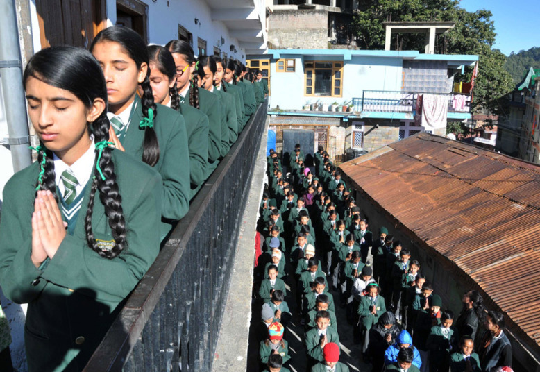 indian schoolchildren pray during morning assembly at their school in shimla as they pay tribute to slain pakistani schoolchildren and staff after an attack on an army school in the restive city of peshawar.PICTURE: AFP/GETTY IMAGES