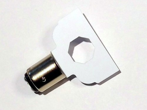 This tool is made of a soft styrene that is a cross-section of our lamp. This will not scratch the light reflector. It installs fully in the socket to confirm clearance before ordering our lamps.