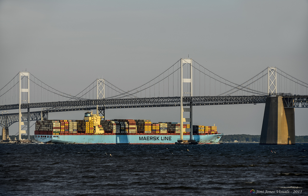 a Maersk Line container ship passes beneath the chesapeake bay bridge
