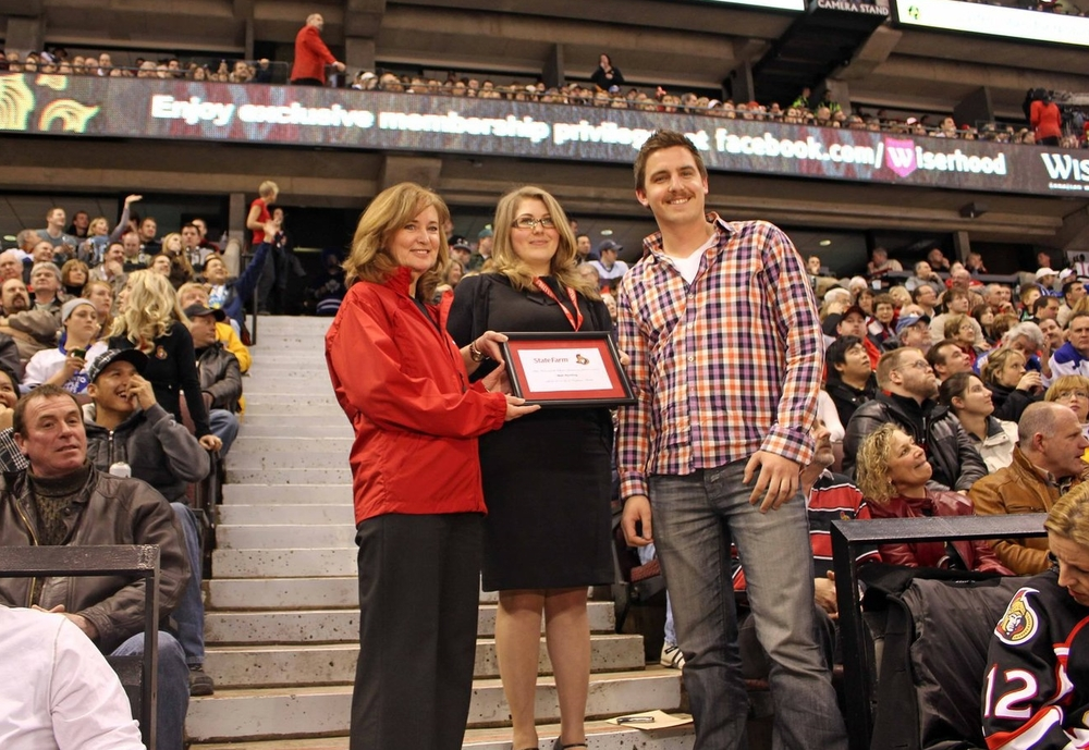 Matt receiving the Ottawa Senator Good Neighbour Award during a commercial break at an Ottawa Senators home game in 2010.