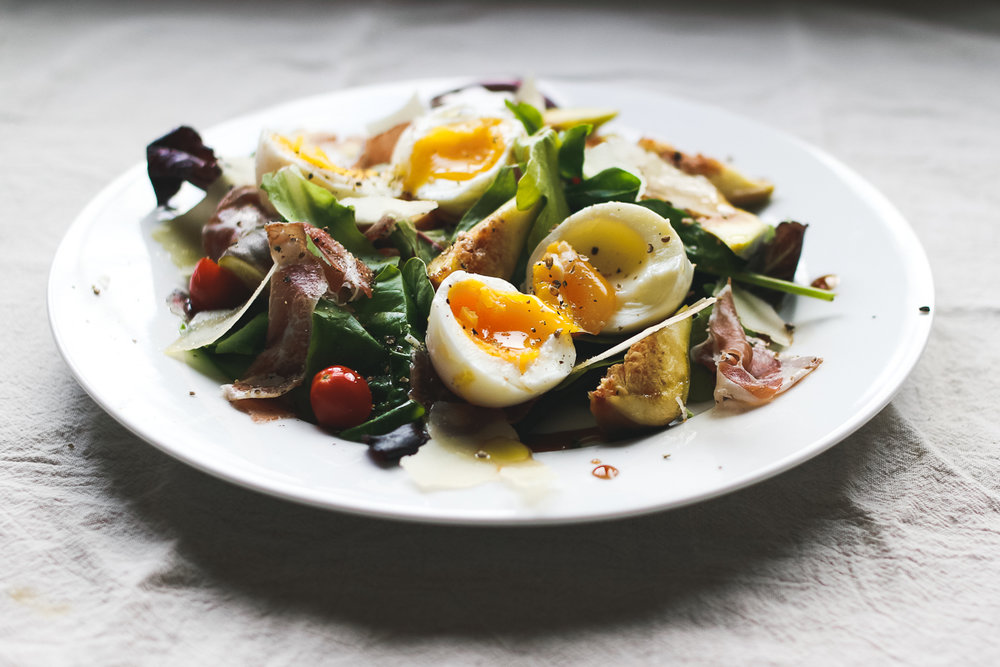 Salad with soft boiled eggs and figs