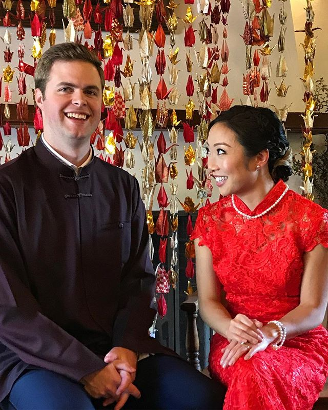 JD and Shanley, smiling and glowing at their tea ceremony in front of the paper crane backdrop we put together out of the many many cranes their lovely families folded! #fourleafcloverstudo