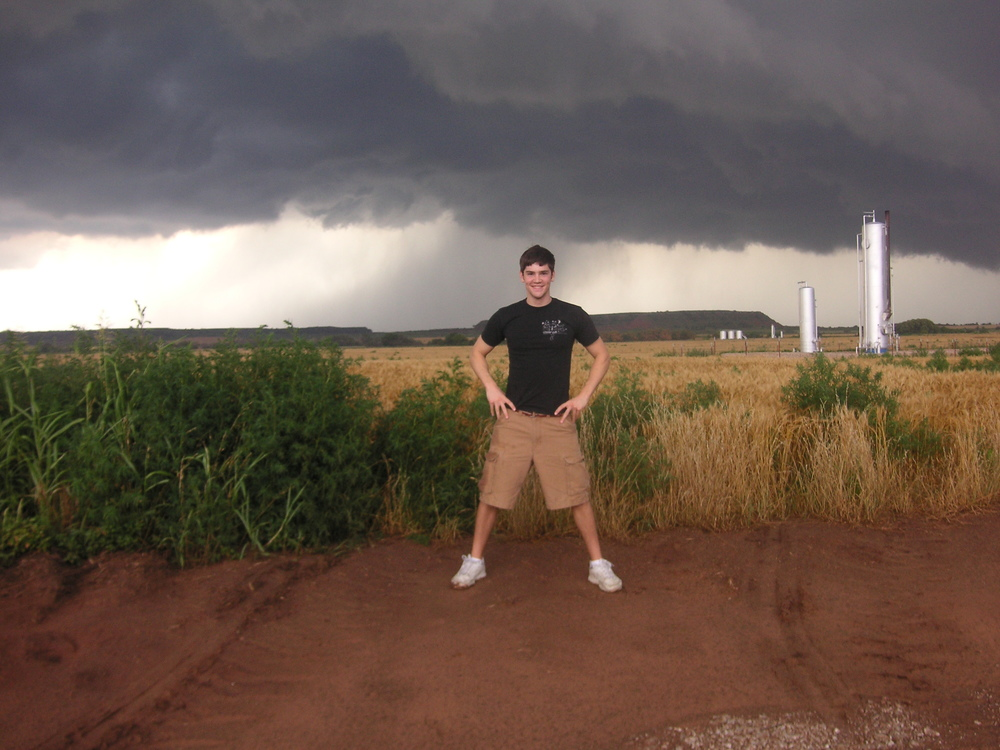 On my first Oklahoma storm chase, in June 2007, grinning ear-to-ear with a supercell behind me.