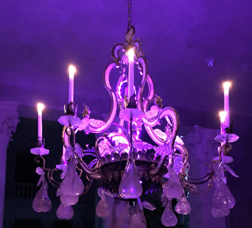 This chandelier uses real candles and is lit from within using our wireless lighting.