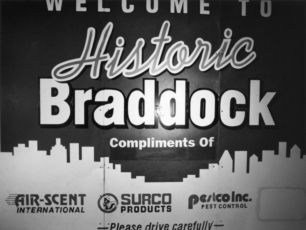 """1980's Welcome to Historic Braddock Signage and a Lightbulb, 2009"" by LaToya Ruby Frazier from the book The Notion of Family."