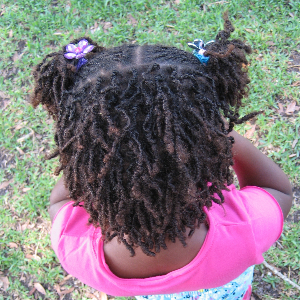 The start of her sisterlocs.