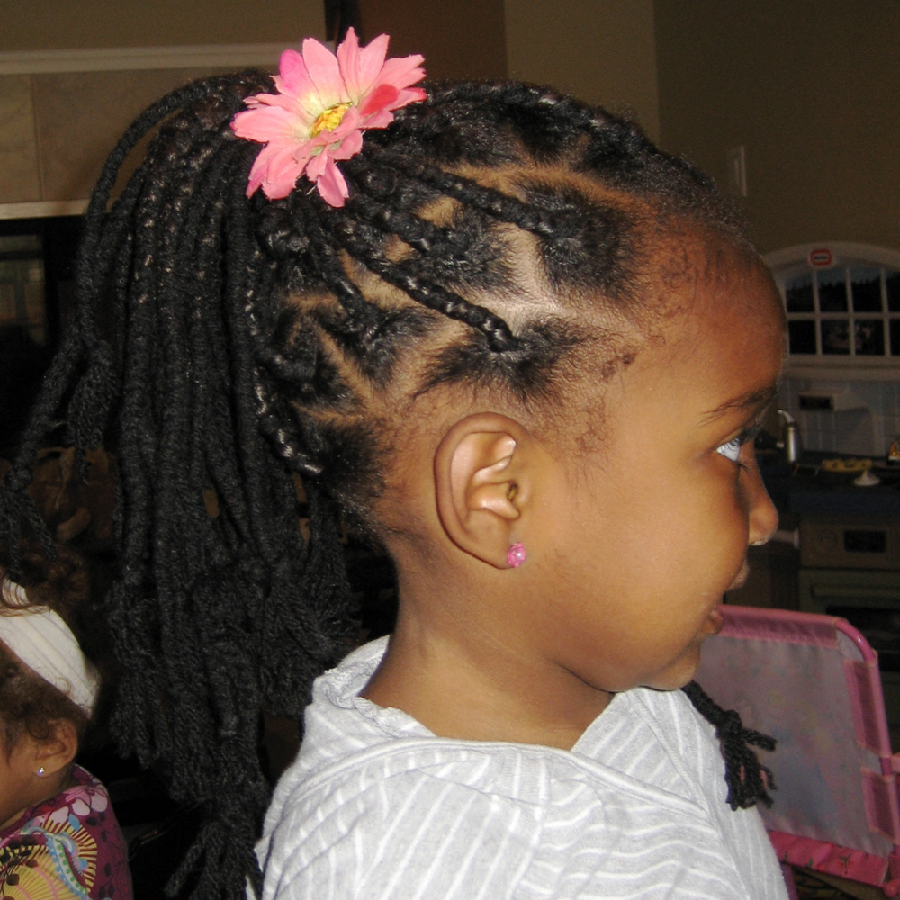 Yarn braids! The quickest and least expensive way to do extensions. She looked like Cabbage Patch Princes Jasmine. So fun.