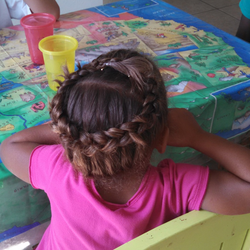 The Princess Crown French Braid.  Looks like the ends came un-tucked.  You get the idea :)