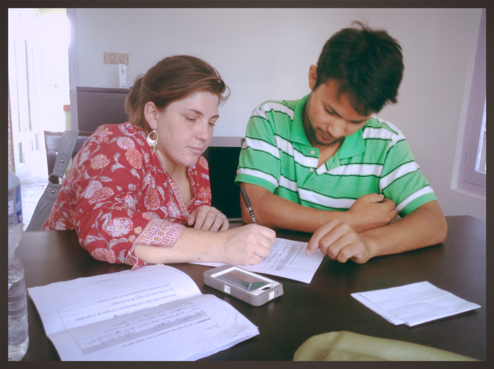 Katrina and Bikash, one of Purnaa's first hires, reviewing applications in the office.