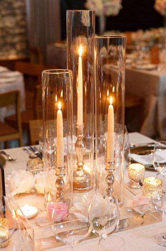 Alternating-votive-and-taper-candles-wedding-centerpiece.jpg