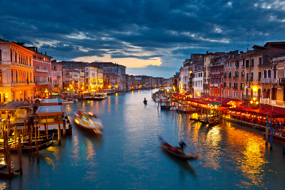 Venice's Grand Canal at night.... sublime and a visually stunning backdrop for the world's most important and long-running contemporary art exhibition-- the Venice Biennale.