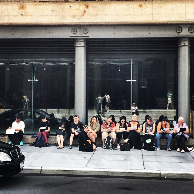 The students sketching outside the Whitney Museum while waiting to get inside. Kenneth is seated first person to the left in the photo.
