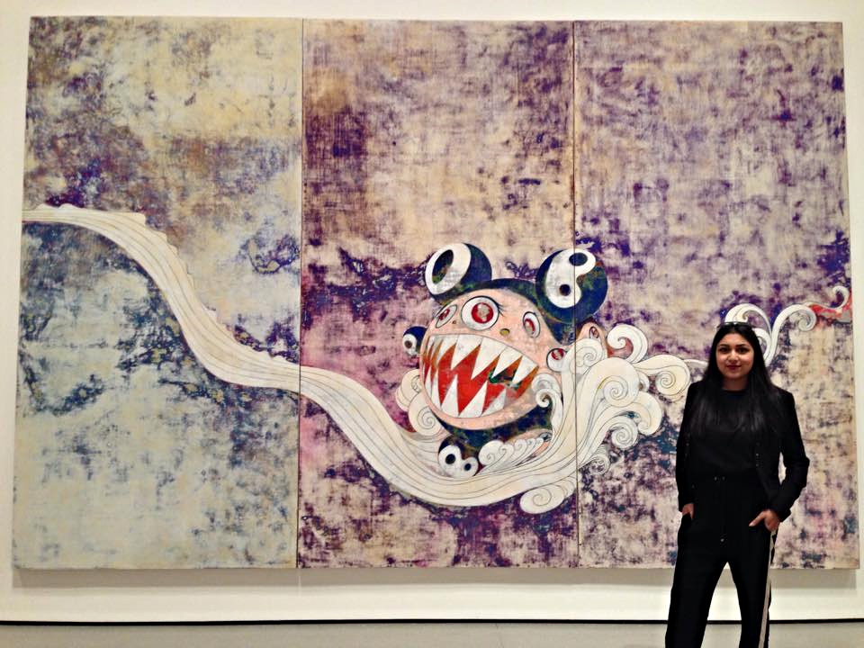 Jessica standing in front of her assigned art work at the Museum of Modern Art-- Takashi Murakami  727  (1996)