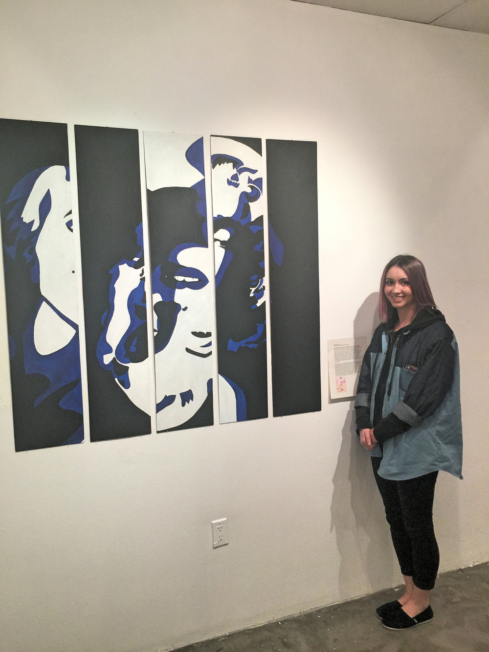 Michelle stands with her response art work to the Rosenquist piece she was assigned from MoMA.