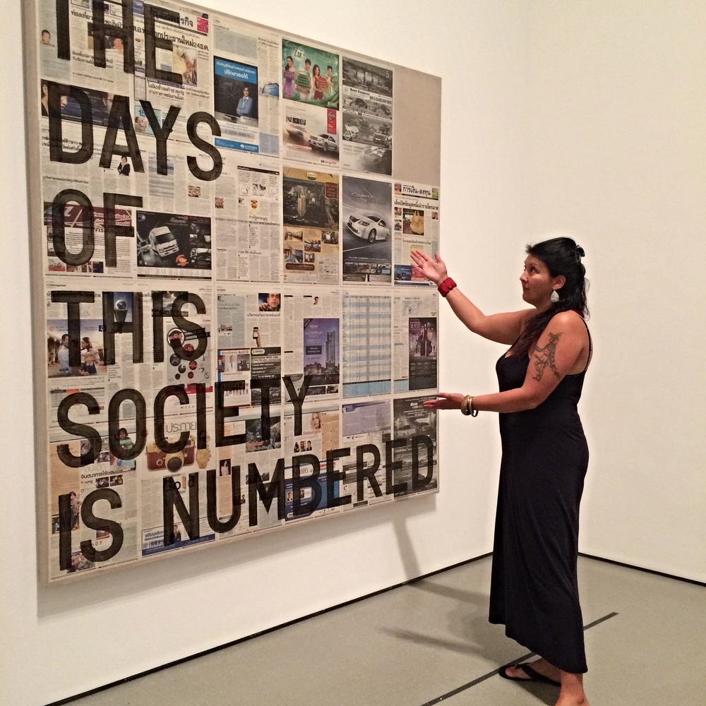 Roxanne presenting her assigned art work from MoMA, Rirkrit Tiravanija's The Days of This Society is Numbered (2014).