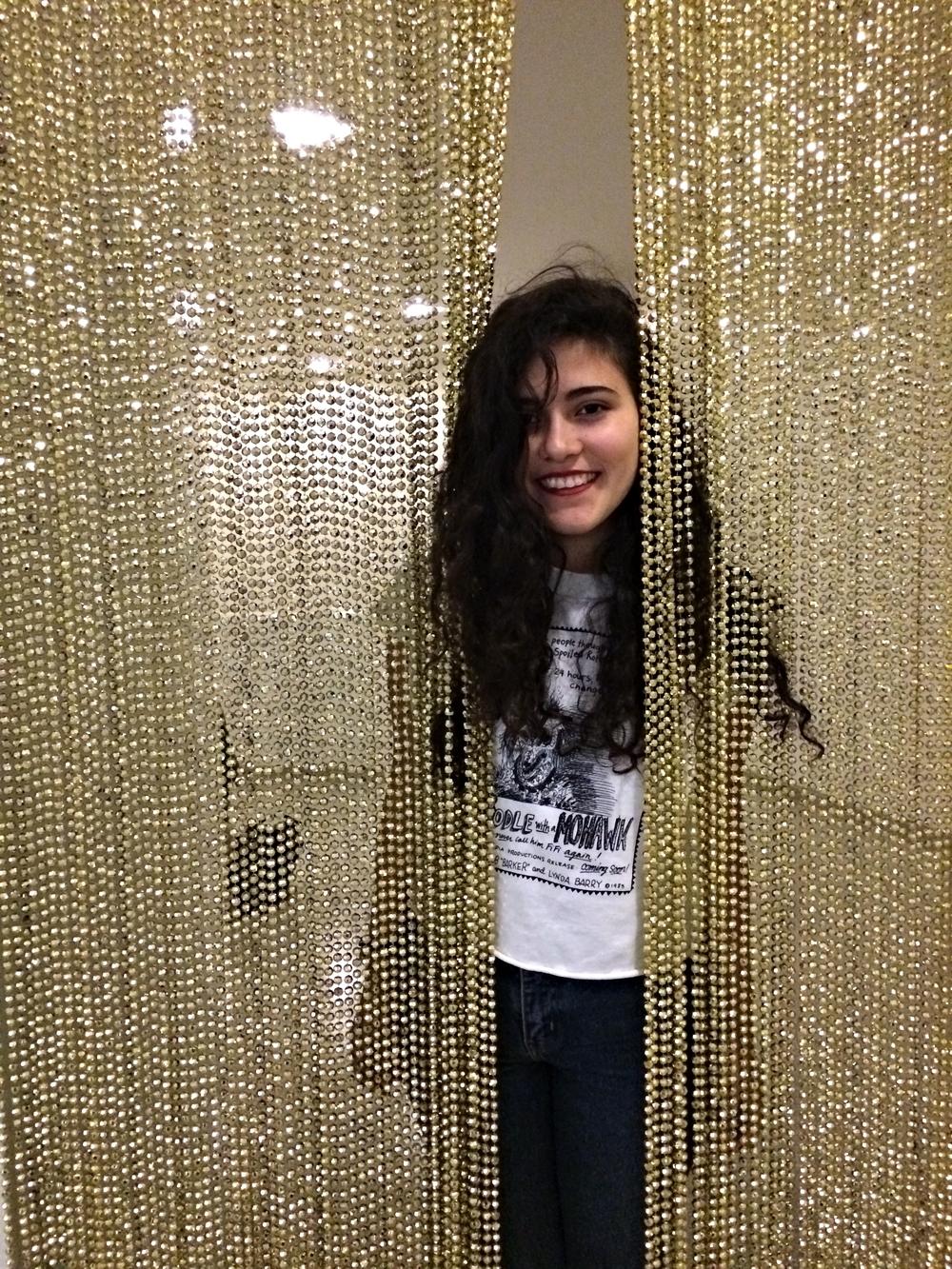 Meet Andi as she parts Felix Gonzalez-Torres'golden curtains ( Untitled (Golden)  at the Guggenheim Museum.