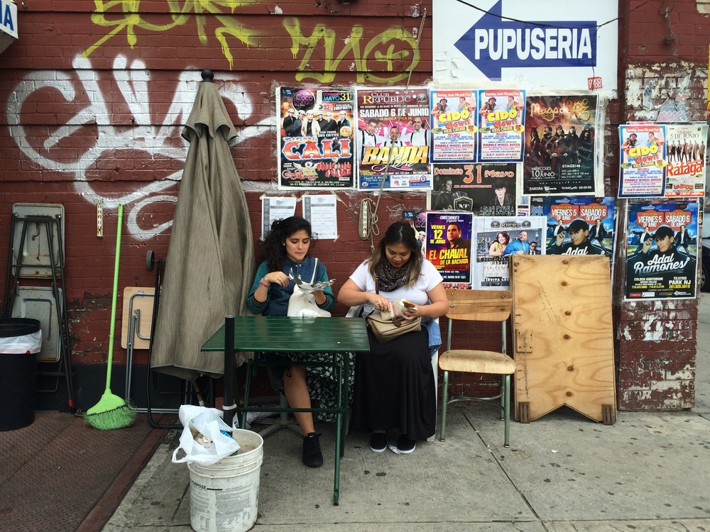 Andi and Pauline   enjoying Salvadorean food on the streets of Bushwick in Brooklyn.