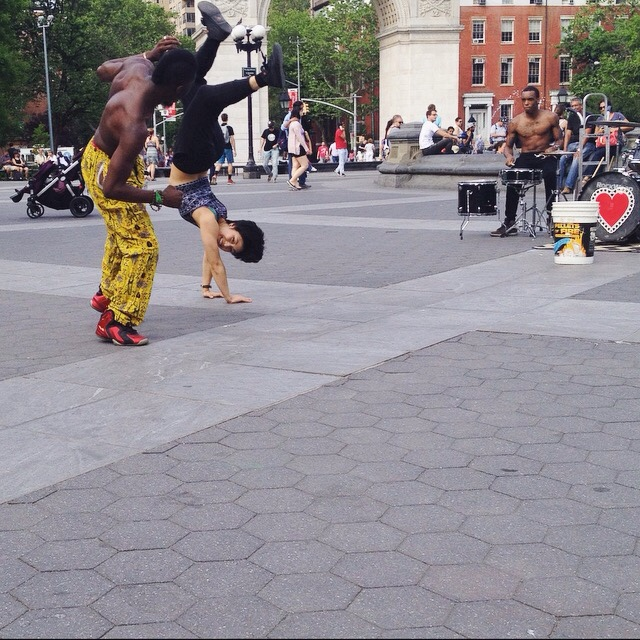 Street dancers and musicians at Washington Square Park.