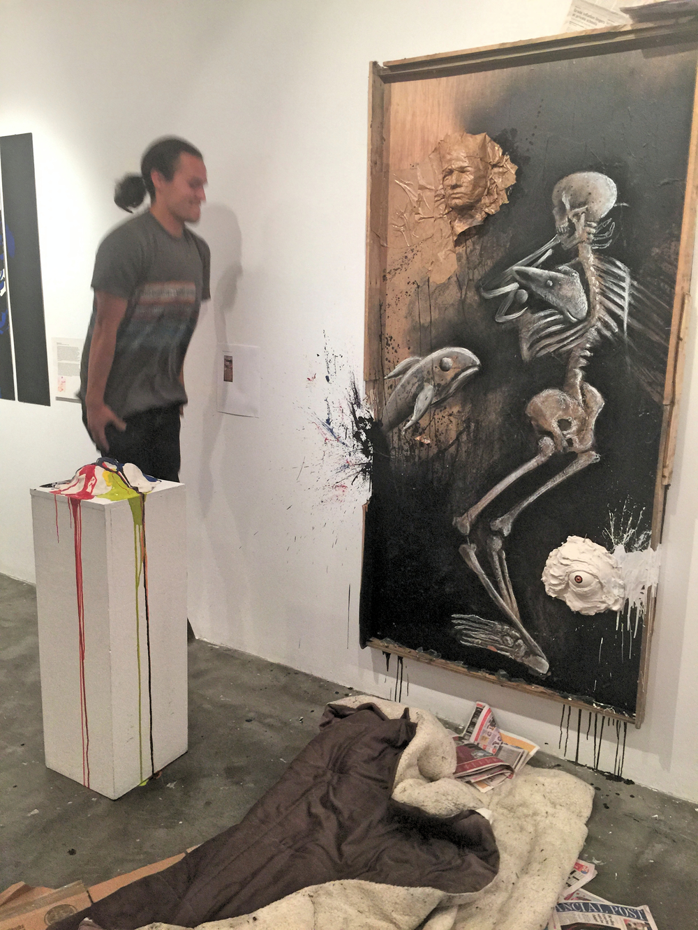 "Cody (always in motion!) next to his response piece to the assigned Rauschenberg, exhibited at the ""Talking Back"" show at KPU prior to departure to New York and Venice."