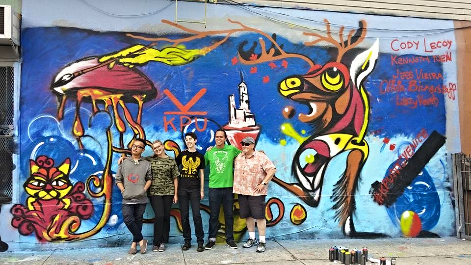 Kenneth, Olivia, Jess, Cody, and Larry pose proudly in front of their completed street art mural in Brooklyn. From what we hear, it is still there!