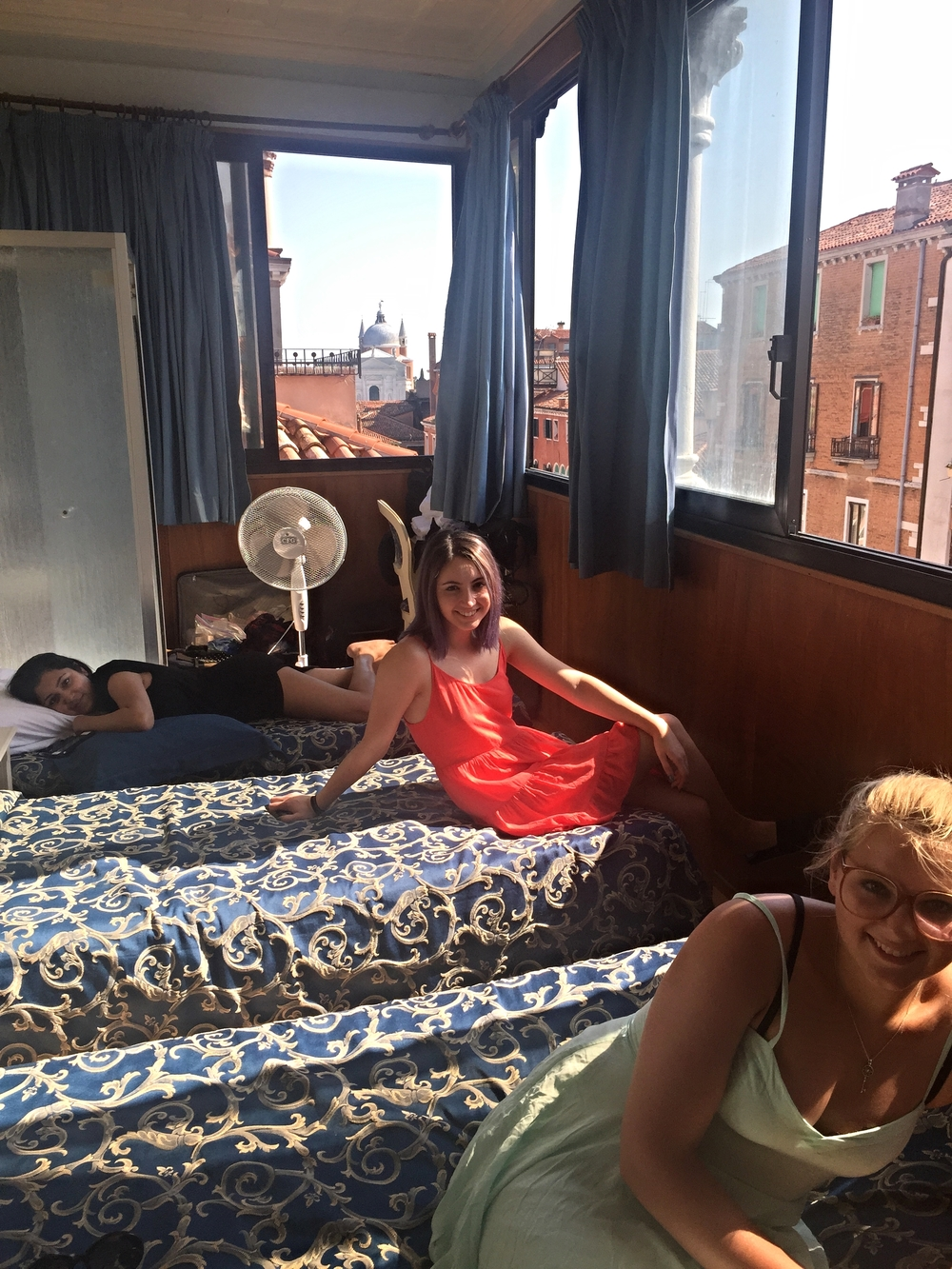 Jessica, Michelle, and Olivia settle into their new temporary home at our Venetian hotel.