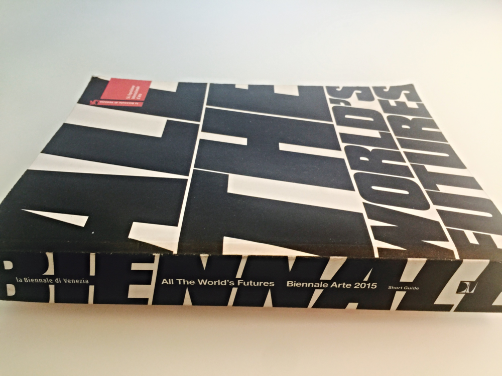 """The compactcatalogue for the 2015 Venice Biennale with this year's theme """"All the World's Futures"""" logo on the cover."""