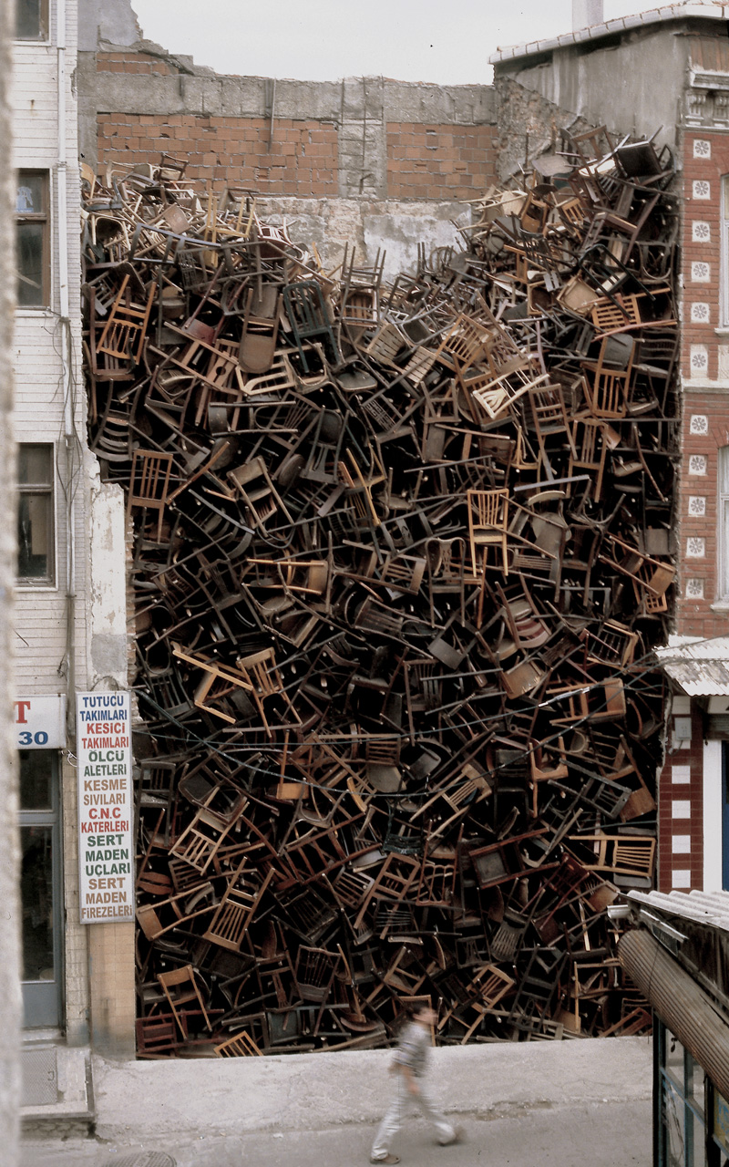 1550 Chairs Stacked Between Two City Buildings is an installation by Doris Salcedo at the 2002 Istanbul Biennial. Her projects are both thought-provoking and visually striking.