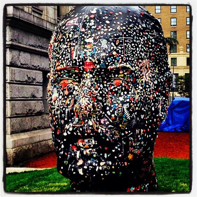 "Douglas Coupland,  Gumhead  (2014)  as featured at the Vancouver Art Gallery in his solo exhibition last spring/summer. Of the seven-foot tall self-portrait, with chewing gum as a primary medium, Coupland has described the piece as a ""crowd-sourced, publically interactive, social-sculpture self-portrait."""